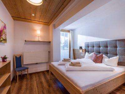 Schlafzimmer App. Typ 2 - Kalle's Appartements ©Hannes Darbernig Fotografie
